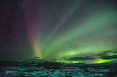Northern lights over the ice lagoon, Iceland Royalty Free Stock Photo
