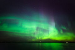Northern lights over lake in finland Royalty Free Stock Image