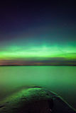 Northern lights over lake in finland Stock Photography