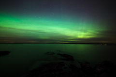 Northern lights over lake in finland Royalty Free Stock Photography