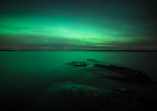 Northern lights over lake in finland Royalty Free Stock Photos