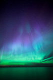 Northern lights over lake in finland. Beautiful northern lights aurora borealis over lake in finland Stock Images