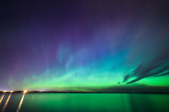 Northern lights over lake in finland Stock Image