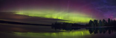 Northern Lights over a Lake in Minnesota during Summer. Northern Lights Shot over Lake Superior Northern Minnesota in Summer royalty free stock photos