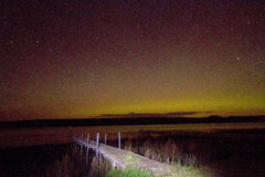 Northern lights over lake Royalty Free Stock Images
