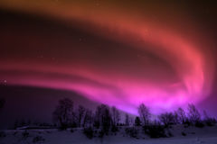 Northern lights over Lapland. Natural phenomenon characterized by a series of lighting effects that form a unique spectacle stock images