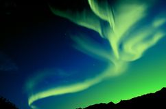 Northern Lights (Aurora borealis). Northern Lights over mountain at night Royalty Free Stock Photo