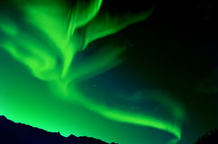 Northern Lights (Aurora borealis). Northern Lights over mountain at night Royalty Free Stock Image