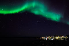 Northern lights over the old harbor of Nuuk city Stock Photo