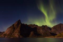 Northern lights over Olstind mountain Stock Photo