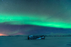 Northern lights over plane wreck on the wreck beach in Vik, Iceland Royalty Free Stock Photography