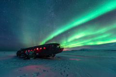 Northern lights over plane wreck on the wreck beach in Vik, Iceland. Northern lights over plane wreck Royalty Free Stock Images