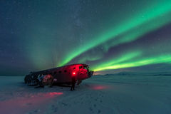 Northern lights over plane wreck on the wreck beach in Vik, Iceland. Northern lights over plane wreck Stock Photos