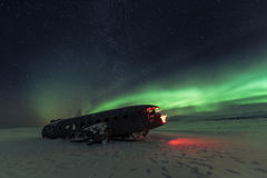Northern lights over plane wreck on the wreck beach in Vik, Iceland Royalty Free Stock Photo