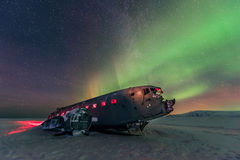 Northern lights over plane wreck on the wreck beach in Vik, Iceland royalty free stock image