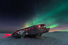 Northern lights over plane wreck on the wreck beach in Vik, Iceland Stock Photo