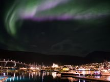 NORTHERN LIGHTS OVER TROMSO CITY royalty free stock images