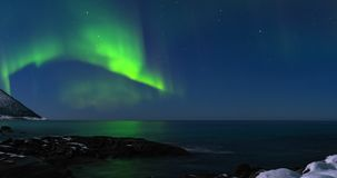 Northern lights, polar light or Aurora Borealis in the night sky time lapse stock footage