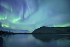 Northern lights reflect on the lake Royalty Free Stock Photos