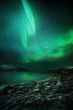 The Northern Lights Rising. The Northern Lights (aurora borealis) as seen from Northern Norway. Contains Noise Stock Photo
