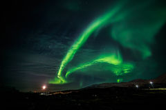 Northern lights and the rising Moon nearby nuuk city stock photography