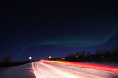 Northern lights and road Royalty Free Stock Image