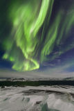 Northern Lights on the shore of the Arctic Ocean Royalty Free Stock Photo