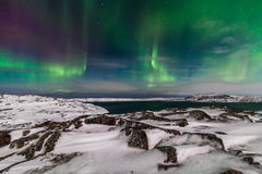 Northern Lights on the shore of the Arctic Ocean Stock Image