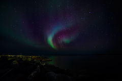 Northern lights on a shore Royalty Free Stock Photos