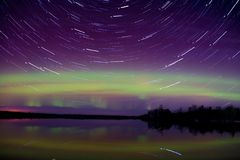 Northern Lights over a Lake in Minnesota during Summer. Northern Lights Shot over a Northern Minnesota lake in Summertime stock photo