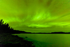Northern lights sky frozen Lake Laberge Yukon Royalty Free Stock Photo