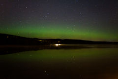 Northern Lights. A starry sky and the northern lights Stock Images