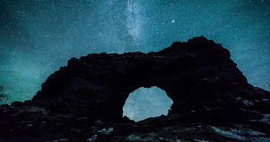 Northern lights and stars (aurora borealis) over volcanic rock formations stock video