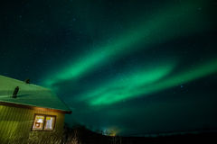 Northern lights in Sweden with cabin Royalty Free Stock Photos