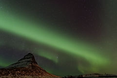 Northern Lights swirling around Kirkjufell, Iceland royalty free stock photography
