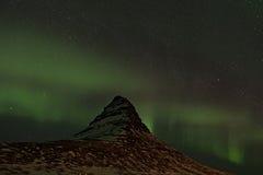 Northern Lights swirling around Kirkjufell, Iceland Stock Photos