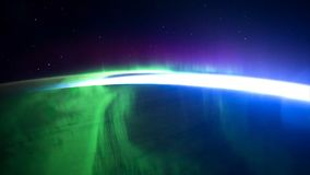 Northern lights view from space. Animation. Northern lights from the stratosphere. Northern Lights over lagoon in. Iceland. Beautiful natural phenomenon Stock Photos