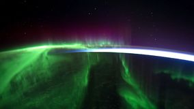 Northern lights view from space. Animation. Northern lights from the stratosphere. Northern Lights over lagoon in. Iceland. Beautiful natural phenomenon Stock Image