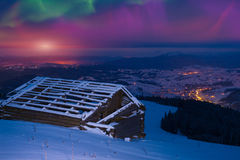 Northern lights in winter mountains Stock Images