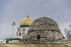 The Northern mausoleum in Bolgar. The ancient Northern mausoleum in Bolgar and modern muslim monument in the background stock images