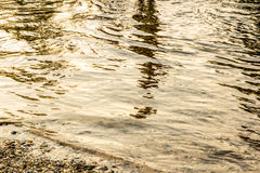 Northern michigan river. Michigan river with shadows, calming waters flowing, rippling water full of life,  beautiful water, water, summer, river, spring Royalty Free Stock Photo