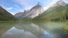 Northern mountain reflection. Mount Harrison Smith reflected in Glacier lake Royalty Free Stock Image