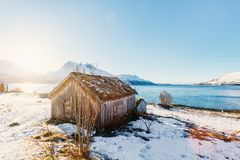 Northern Norway. Beautiful winter landscape of Northern Norway with wooden huts overlooking breathtaking fjords scenery Stock Photo