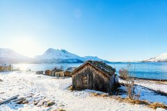Northern Norway. Beautiful winter landscape of Northern Norway with wooden huts overlooking breathtaking fjords scenery Stock Images