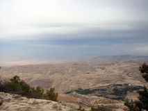 Northern part of Jordan. Moses mountain Nebo. Panorama from bird`s-eye view. Landscape from the bird`s eye view of a cloudy winter sky above the sand dunes of stock images