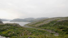 Northern polar landscape with lake in  summer. Hills near the Barents Sea stock video