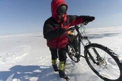 Northern Pole. Biker going on ice. Lake Baikal, Eastern Siberia Stock Photo