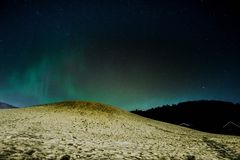 Northern powers. Northlights over a viking grave Royalty Free Stock Image