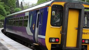 Northern Rail Diesel Train. A Northern Rail diesel train departs Wetheral station.  Northern Rail is a train operating company operating a rail franchise in stock video footage