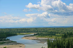 Northern River. A bend in the North Saskatchewan River, Alberta, Canada. The foothills of the Rocky Mountains are in the background stock photos